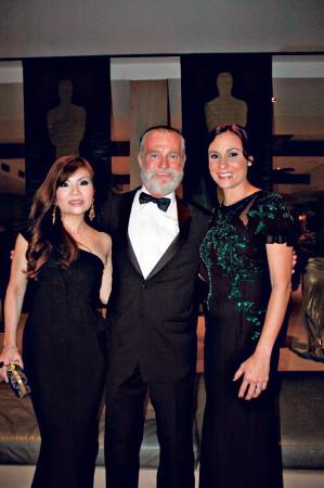 HIFF executive director Chuck Boller (center) with event chairwomen Kristen Chan and Nicole Kobayashi.
