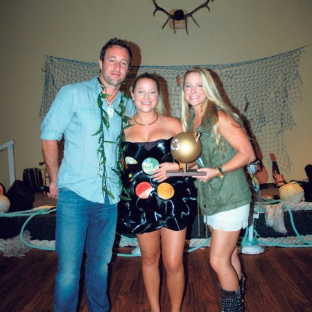"""Sustainable Coastlines hosted its annual fundraiser, I Heart The Ocean, at the Elks-Honolulu Lodge featuring a marine debris fashion show or """"trashion"""" show, competition. Hawaii Five-O star Alex O'Loughlin served as host and celebrity judge. He's pictured at left with the trashion show winner, designer Allycen Keatley and model Emilee Keatley, who's wearing a dress made of recycled records"""