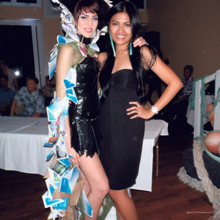 Trashion show first runner- up, designer Feliz Salas, with model Sarah Ferge, who's wearing a dress made from duct tape and garbage bags and a cape from old magazines and brochures.