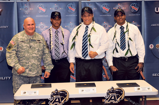 "Maj. Gen. Joseph Chaves, deputy commander, U.S. Army Pacific, leads new cadets Shaun Kagawa, Jaryn Villegas and Paul-Andrew Rhoden in a cheer of ""Go Army, Beat Navy"" during the West Point football signing ceremony at Fort Shafter."