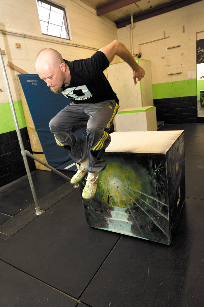 Keith Mylett of Precision Parkour does a parkour move known as a kong vault over a box that's more than 3 feet tall   Leah Friel photo