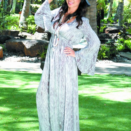 Sandy Kaneda: Love Shack Fancy 'Georgette' snakeskin maxi dress $595, Lola Hat 'Loveseat' hat $325, and Hipchik Couture 'Hattie' necklace $350 and 'Maggie' elephant necklace $350