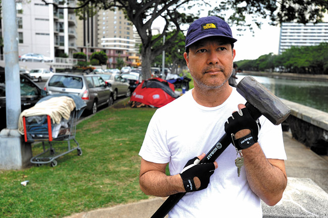 Rep. Tom Brower and his hammer. Honolulu Star-Advertiser photo