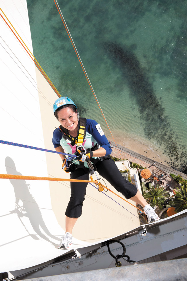 Starting my 31-story rappel down the Sheraton Waikiki for Special Olympics Hawaii | Leah Friel photo