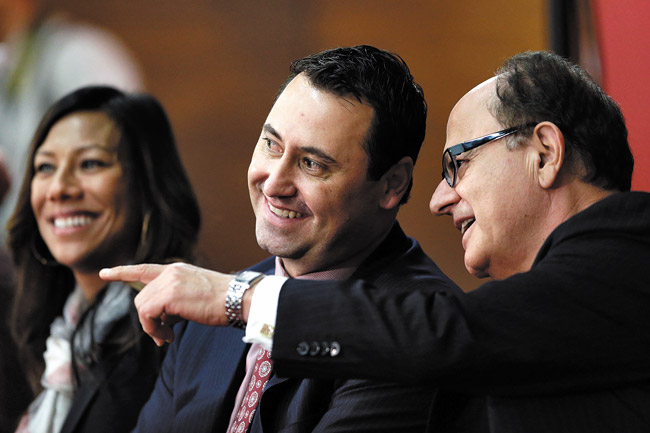 New USC football coach Steve Sarkisian (center) with wife Stephanie and USC USC president C. L. Max Nikias during a news conference last Tuesday announcing his hiring | AP Photo/Jae C. Hong