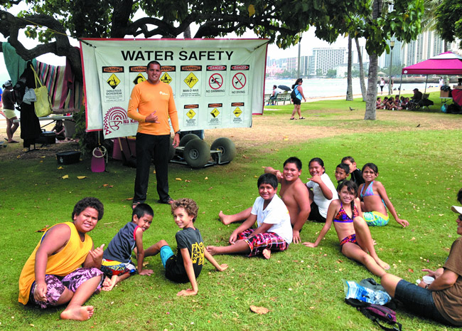 Duane DeSoto leads a water safety clinic at Waikiki. Photo from Duane DeSoto / Na Kama Kai