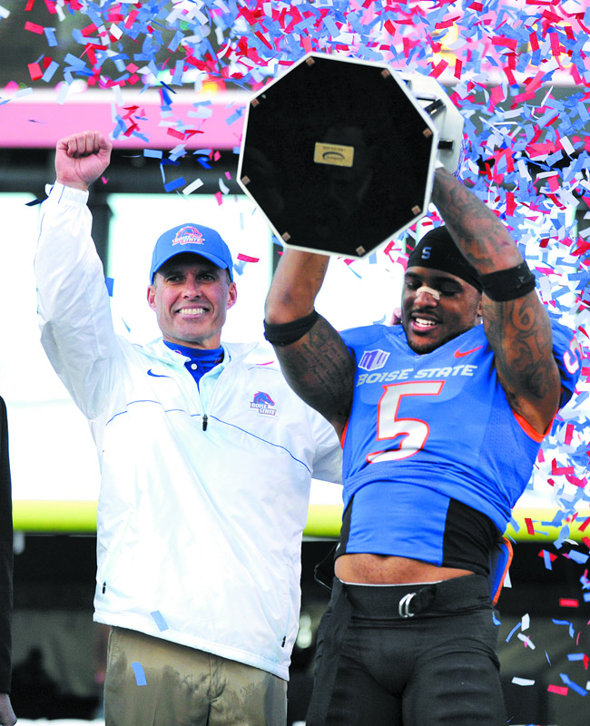 Former Boise State coach Chris Peterson (with cornerback Jamar Taylor) has created a mid-major monster that has increased the fortunes of the school and the Mountain West Conference. His move to Washington puts much of that in peril | AP Photo/David Becker