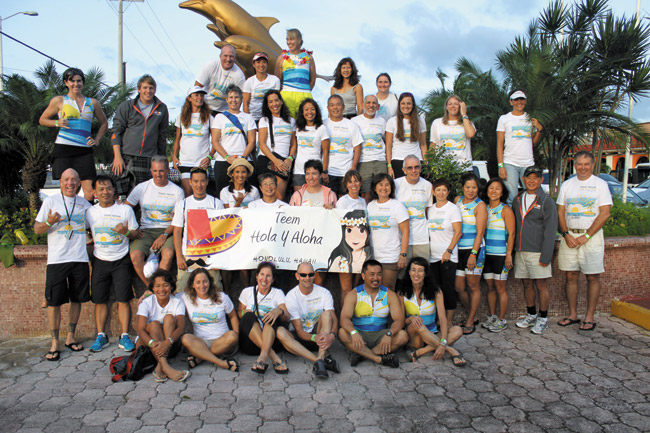 There were at least 40 triathletes representing Hawaii at the Dec. 1 IRONMAN race in Cozumel, Mexico. Some of them are pictured here, along with their supporters. Rick Keene photo