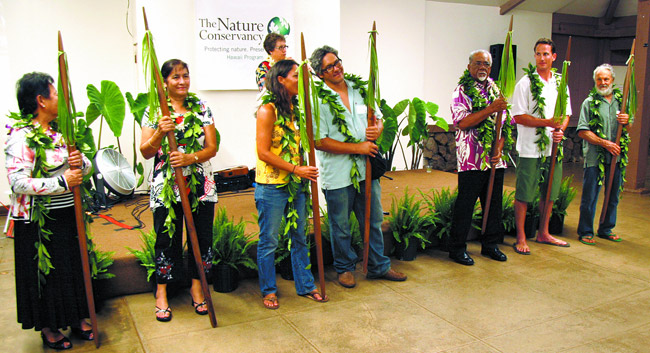 The Nature Conservancy presented its annual Kako'o Aina Award recently at He'eia State Park to seven Windward partners, represented by (front, from left) Jo-Ann Leong, Mahealani Cypher, Hi'ilei Kawelo, Rick Barboza, Jerry Kaluhiwa, Jono Blodgett and Charles Reppun. Photo from TNC.