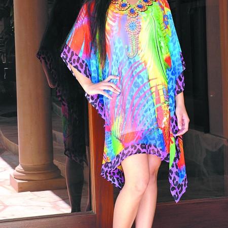 Brandi Hughes: Rainbow animal print caftan $68, LBDB white cami dress $24, Allison Lynn Couture gold hoop and chain earrings $75