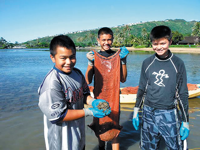 Students (from left) Jonah K., Jaydon T. and Maxwell S. show off their catch of mudweed and gorilla ogo removed Dec. 17 from Maunalua Bay by Kuliouou, where invasive species continue to choke out native marine plants. The boys from Our Lady of Good Counsel School were on a field trip from their Pearl City campus. All told, they collected nearly 140 bags of unwanted seaweed in four hours. Malama Maunalua's next 'huki event' is this Friday, meeting at 9 a.m. at Kuliouou Beach Park. Call 395-5050 or see Highlights on Page 11. Photo from Ginger Kamisugi.