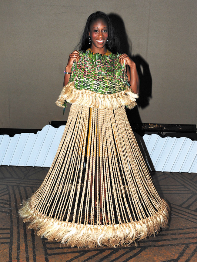 Ensemble dancer/singer Amyia Burrell with her Grasslands costume. Burrell, who has 14 costume changes in the show, including Lioness, Hyena, Zebra and Wildebeest, has been with THE LION KING for seven years