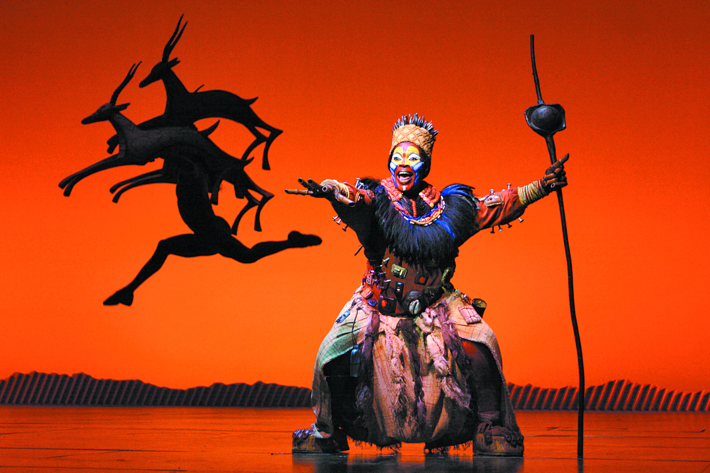 Brown Lindiwe Mkhize as 'Rafiki' in the opening number 'The Circle of Life' from 'THE LION KING' National Tour | Joan Marcus photo / ©Disney