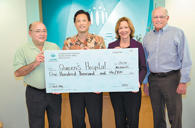 UHA Health Insurance recently donated $100,000 to The Queen's Medical Center to fund the completion of its new West Oahu facility. Pictured (from left) are Queen's Medical Center president Art Ushijima, UHA president and chief executive officer Howard Lee, chief executive officer of Queen's–West Oahu Susan Murray and UHA chief medical director Dr. George McPheeters. Photo from UHA Health Insurance.