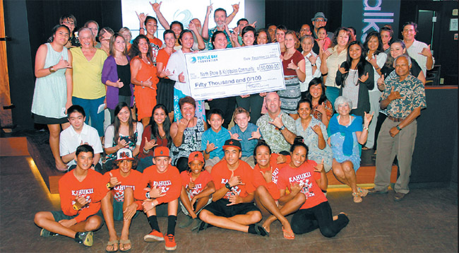 Turtle Bay Foundation awarded $50,000 in grants and scholarships to nonprofits and college-bound students in Windward and North Shore communities Dec. 10 at the resort's Surfer, The Bar. Big winner of the day is represented by the folks in the familiar red shirts (Red Raiders). Photo from the Anthology Group.