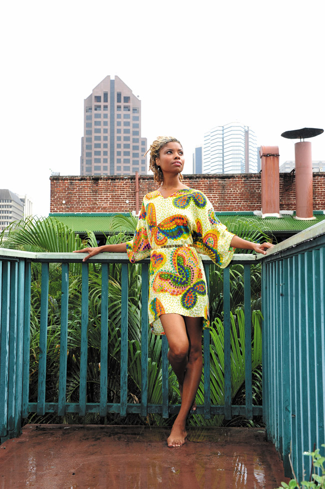 Letrice Mitchell: 1960s butterfly print tunic $20, gold belt $12