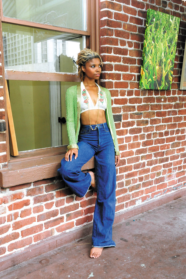 Letrice Mitchell: Handmade 1960s silk beaded green and gold cardigan $45, 1970s handmade embroidered halter top $12, 1970s high-waist denim bell bottoms by Pentimento $20, gold chain costume jewelry $16
