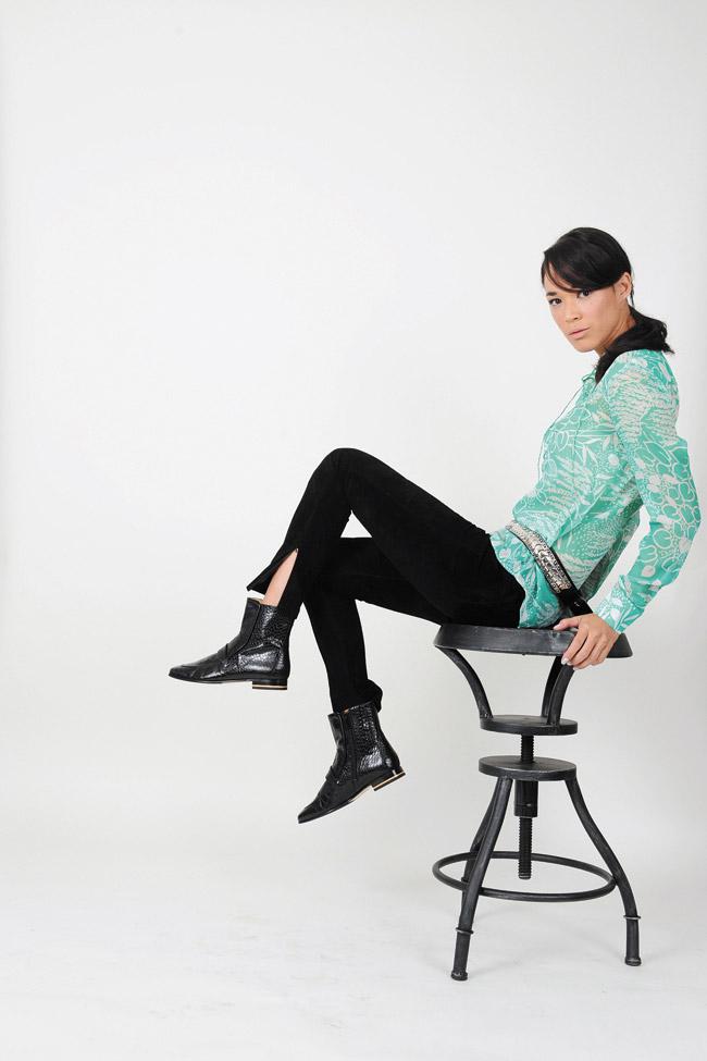 Nicole Broderick: H&M green/white print blouse $49.95, H&M black suede leggings $149, H&M black ankle boots $129, H&M belt $49.95