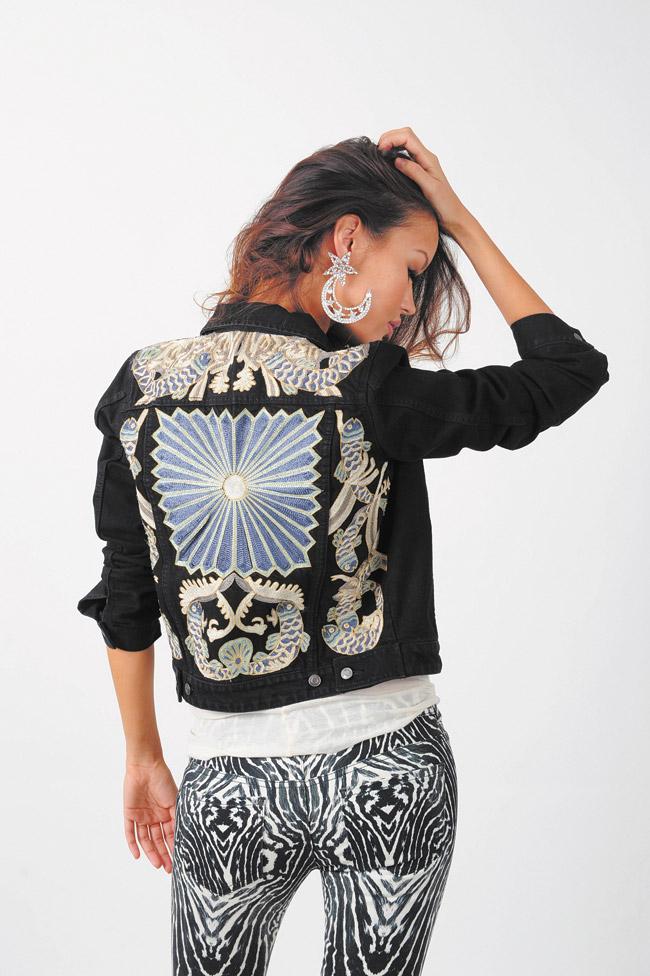 Angela Byrd: H&M zebra print jeans $59.95, H&M cream racerback tank top $12.95, H&M black denim jacket with embroidery $129, H&M earrings $17.95