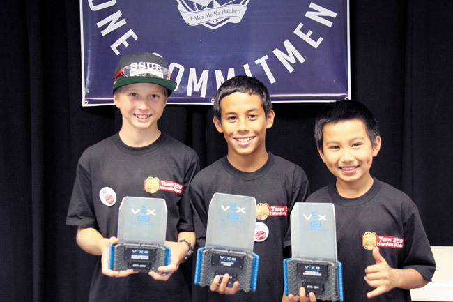 Waialua students Sonny Ciaruffoli, Chai Caplili and Zane Balmoja show off their VEX robotics trophies. Photo from Megan Andrada.