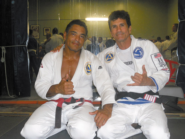 Romolo Barros (right), founder of the Hawaii Triple Crown of Brazilian Jiu Jitsu, with his mentor Rickson Gracie. The Hawaii Triple Crown of Brazilian Jiu Jitsu will have its first event of the series, the Hawaiian Open Championship, May 3 at Pearl City High School | Photo courtesy Romolo Barros