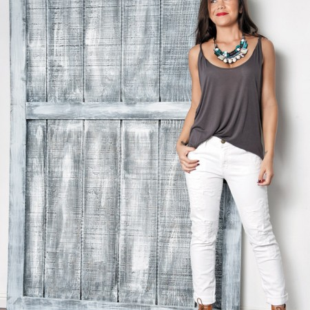 Kainani Clark: Nocturne handmade necklace with Italian beads $230, Daydreamer gray low-back tank $68, Current/Elliott white jeans $248, Joie brown lace-up booties $325