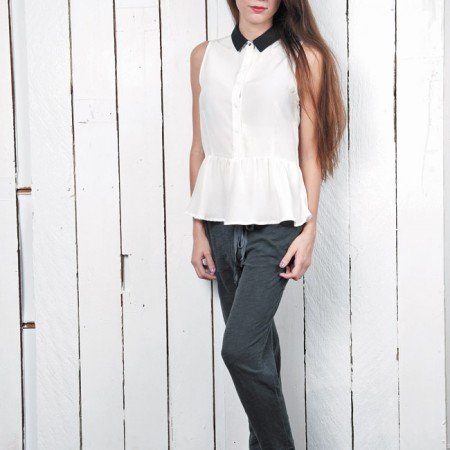 Sierra Vaughn: Wren contrast collar top $253, Wilt vintage black crop sweatpants $106, Kidmore' slip-on sneakers $190