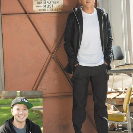 Designer: Christopher Kim Model: Kevin Ko Outfit: Full zip-up hooded jacket and dark wash jeans with suspender straps