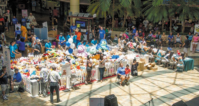 The 'barnyard' was full last year at Windward Mall's center court, where Prevent Child Abuse Hawaii attempted to break the Guinness World Record for 'largest gathering of plush toys.' They'll try again this year, from 10 a.m. to 2 p.m. Saturday. Called the Teddy Bear Round-Up, the event also aims to bring comfort to many of Hawaii's abused and neglected children. Photo from Aileen Deese.