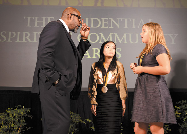 Actor Forest Whitaker congratulates Kayla Kawamura (center) and Hannah Button on being named Hawaii's top two youth volunteers for 2014 at The Prudential Spirit of Community Awards ceremony. Photo from Prudential Finance.