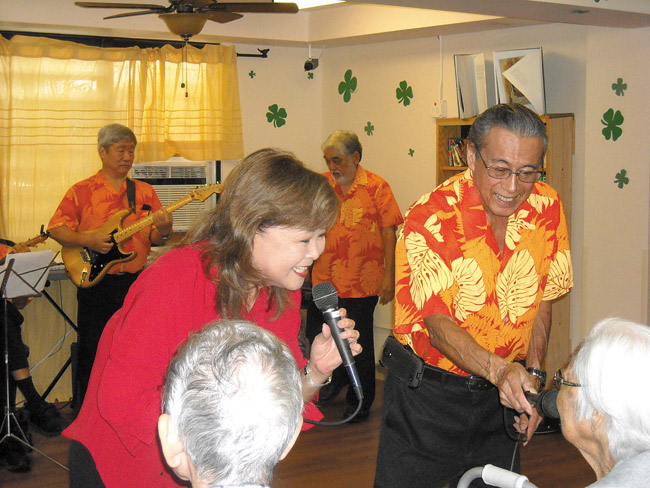 Amy Fukunaga and Barry Jay of Ebb Tides perform before their audience of kupuna during a St. Patrick's Day celebration at Manoa Cottage Kaimuki. Photo from Calvin Hara.