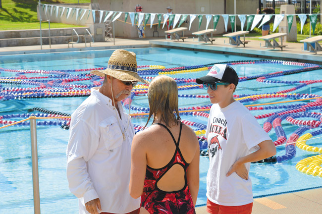 Bruce Kennard with (from left) swimmer Maureen Michels, age 13, and coach Cassie Pardee | Don Edelheit photo