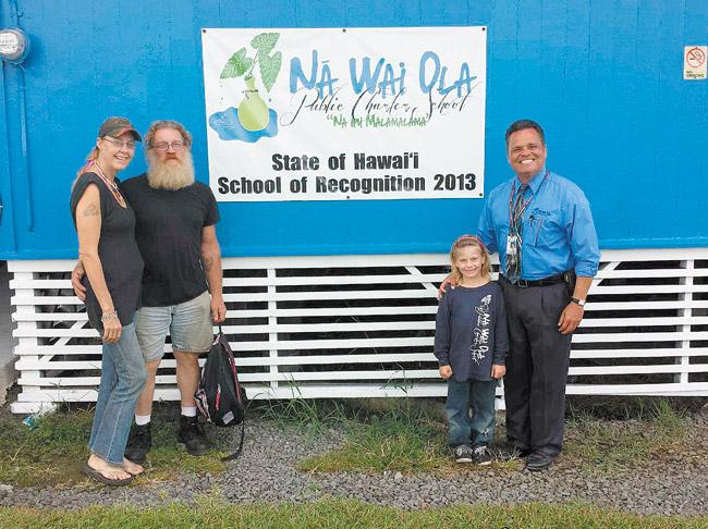 Anne Boog, Tim Hendricks, Harley Marie Hendricks and principal Daniel Caluya in front of Na Wai Ola Elementary | Photo courtesy Daniel Caluya
