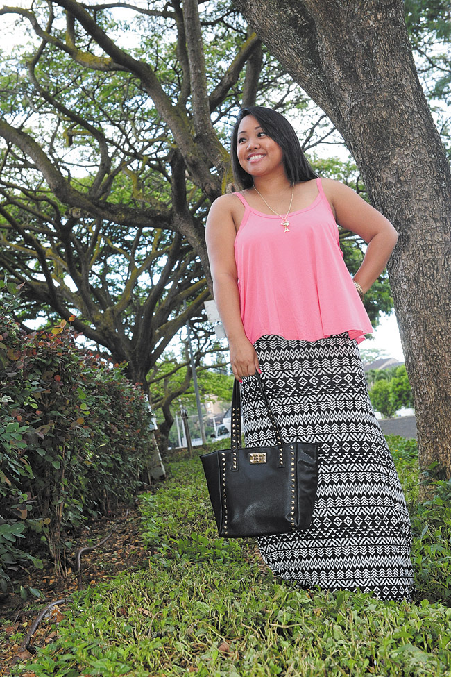 Chelsea-Andrea Crowell: Sleeveless coral knit top $12.99, Always...Me tribal maxi skirt $19.99, black tote bag with gold studs $19.99, Marysol 'Eiffel Tower' necklace $3.99