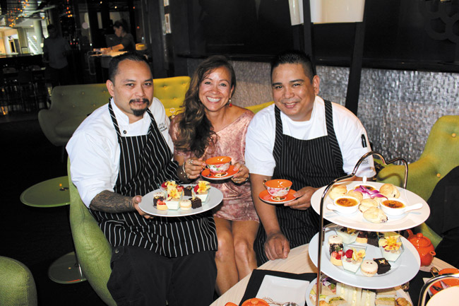 Stage Restaurant and Tea at 1024 present Low Tea in The Lime Lounge. Guests can now enjoy traditional afternoon tea served on low tables in the foyer of Stage Restaurant atº Honolulu Design Center. Pictured here are Michele Henry with pastry chef Cainan Sabey on the left and Stage executive chef Ron de Guzman on the right.