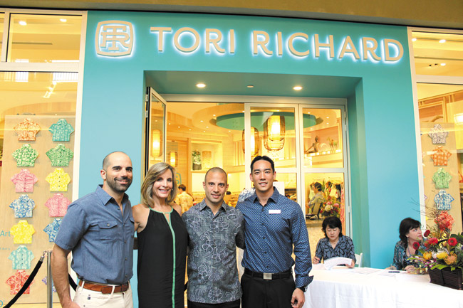 Tori Richard celebrated the opening of its new Ala Moana store in the Nordstrom wing, with a special event featuring entertainment by Taimane and pupus by chef Wade Ueoka of MW Restaurant. Pictured here are Tori Richard president/CEO Josh Feldman with wife Lori, Tori Richard general manager Jason Zambuto and MW Restaurant manager and wine director Ian Hatada.