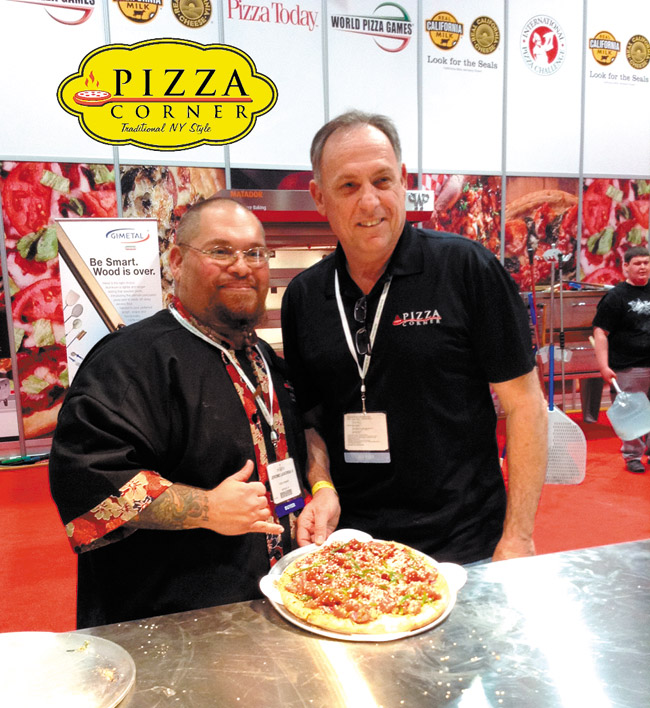 Pizza Corner's executive chef Jerome LaSorba II (left) and owner Frank Mento with their award-winning poke pizza at the International Pizza Challenge in Las Vegas. Photo from Frank Mento.