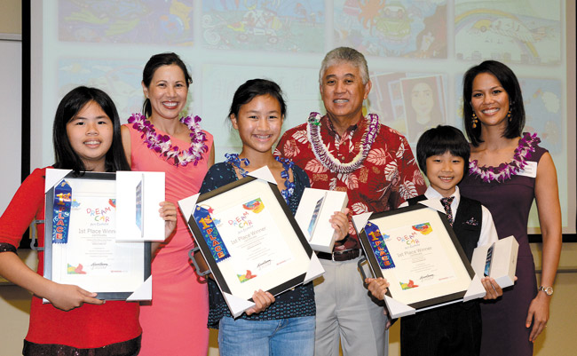 The three state age-category winners in the Toyota Hawaii 2014 Dream Car Contest are (front, from left) Sheena Rae Reyes of Waimalu Elementary (ages 8-11), Kaneohe's Emily Stone of Kamehameha Middle School (ages 12-15) and Ryan Kanda of Kainalu Elementary (under 8). They each won $100 and an iPad Mini and will have their car designs sent on for judging in the Toyota World Contest. Congratulating them at the April 19 ceremony are (back, from left) TV news anchor Tannya Joaquin, Toyota Hawaii senior vice president Glenn Inouye and Shriners Hospital's Mahealani Richardson. Photo from Pang Communications.
