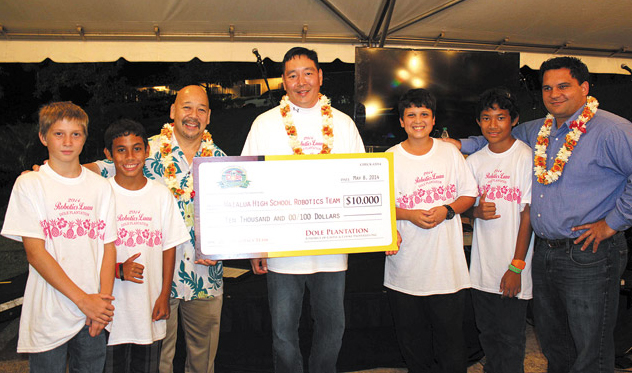 Waialua teacher Glenn Lee (center) and members of the Waialua Robotics team, along with City Council Chairman Ernie Martin (third from left) and state Rep. Richard Fale (far right), accept the $10,000 donation raised at Dole Plantation's annual fundraising luau. Photo from Dole Plantation.