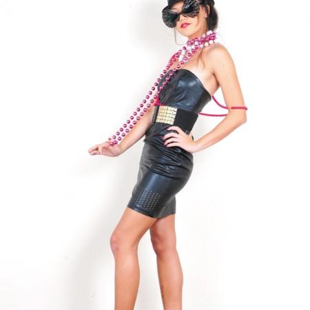 Model: Malia Chaffee Stylist: Amy Azada Merona fedora $5.99, Basta studded belt $2.99, Wet Seal leather mini dress $6.99, Ponny Loves Honny gunmetal heels $12.99, sunglasses $2.99, costume jewelry $3.99