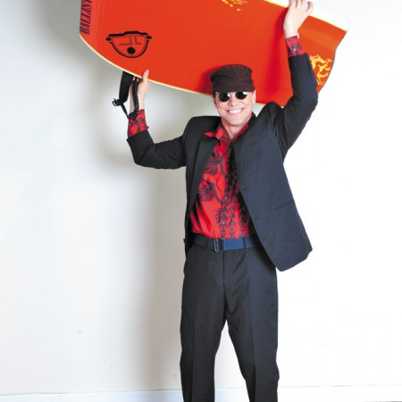 Model: George Johnson Stylist: Paul Brown Mamo Howell red aloha print shirt $8.99, Calvin Klein suit $35.99, brown hat $2.99