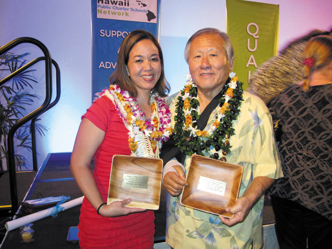 State Sen. Jill Tokuda and Rep. Ken Ito accept the 2013-14 Legislators of the Year award from Hawaii Public Charter Schools Network at the network's annual dinner May 15 at Dole Cannery Ballrooms, Among other awardees cited for their support of charter schools was K. Kahau Glassco of Ke Kula o Samuel Kamakau Laboratory Public Charter School in Kaneohe, named Governing Board Member of the Year. Photo from Roxanne Kamalu.