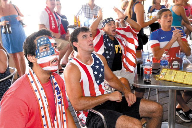 Jose Rodriguez, from left, Mark Dickinson, Luke Cantin, and Christian react to play early in the World Cup soccer match between the United States and Belgium last Tuesday in Jacksonville Beach, Fla. (AP PHOTO/THE FLORIDA TIMES-UNION, BOB MACK)