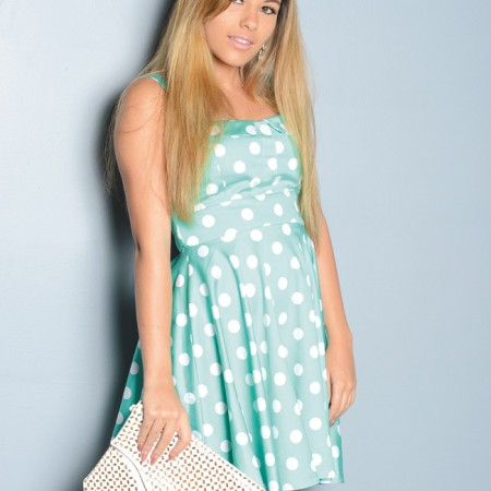 Kyra Armstrong: Cookies mint polka dot dress $56.95 and white clutch $45.95 from Cookies Clothing Co.