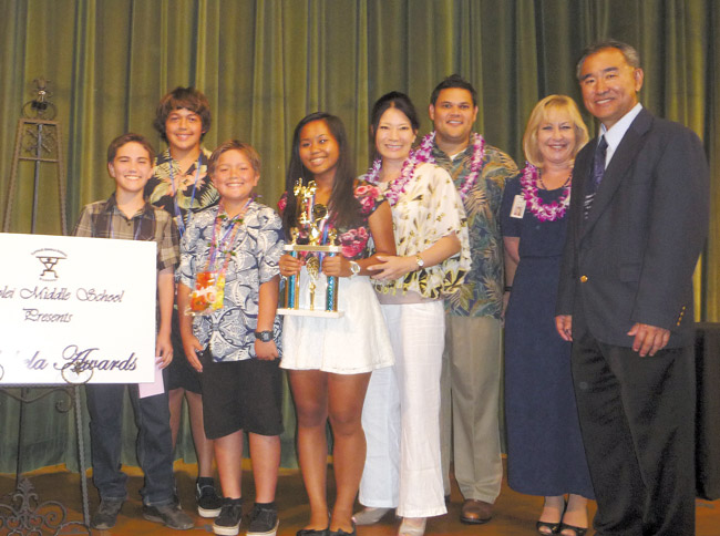Among Kapolei Middle School's 192 recipients of this year's Po'okela Award are (from left) Rusty Neitzel (grade 7), Hunter Copp (grade 7), Cody Liu (grade 6) and Rachelle Lariba (grade 8). The students were presented with their awards by Reps. Sharon Har and Ty Cullen, complex area superintendent Heidi Armstrong, and principal Bruce Naguwa at a June 13 ceremony. Photo from Rep. Har's office.
