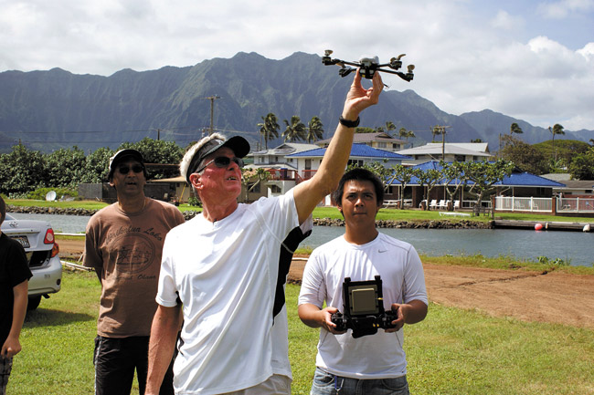 Getting set to launch a drone are (from left) Herb Lee Jr., Ted Ralston and Pookela Academy student Franklin Root, who is handling the remote controls. The academy's outdoor classroom is one of several that Castle High School has lined up with community partnerships to bring hands-on learning into the curriculum. Photo from Castle Redesign.