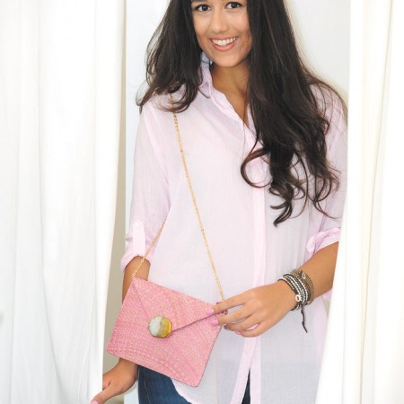 Tiana Koch: Sundry oversized shirt in pink $114, Current/Elliott 'The Fling' boyfriend jeans $198, Kayu 'Capri' straw bag in agate pink $185 (Model Tiana Koch / Larson Talent)
