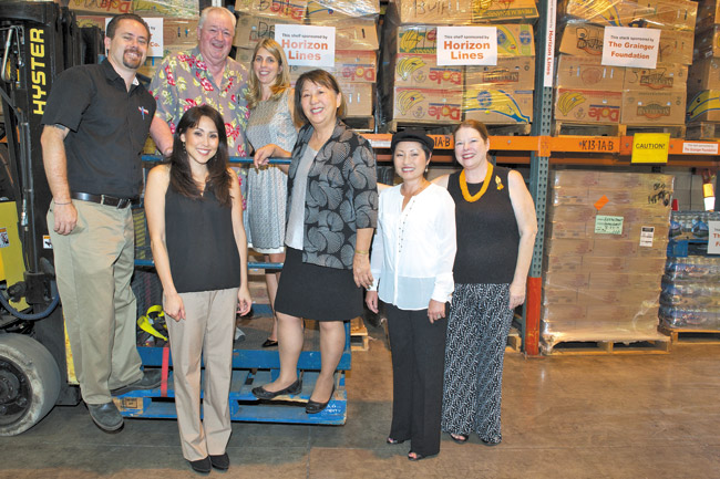 (from left) Grainger Foundation operations manager Jeremy Heen, Hawaii Foodbank president and CEO Dick Grimm, Cutter management CO audit and tax management Kim Fujikawa and vice president Heather Cutter, Hawaii Foodbank board chairwoman Linda Chu Takeyama, Horizon Lines customer service and documentation manager Kelly Murata, and Hawaii Foodbank vice president and COO Polly Kauahi