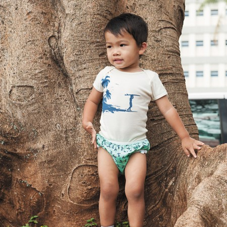 Tobias Sanchez: Little Sprouts tee specially printed with eco-friendly inks $22 from Beach Bums Kailua, Smart Bottoms swim diaper $15 from Beach Bums Kailua, Attipas two-tone natural $29.99 from Happy Tots Hawaii (two pairs for $50 at expo)